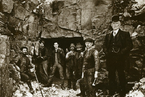 CROP_A group of men standing by a mine entrance_Nippissing